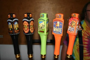 Lakefront Brewing Company lineup of taps at the bar where you wait for the tour.