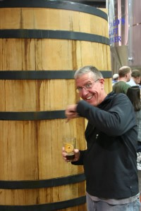 Rich excited that he has found an oak barrel in which to top off his beer!