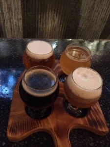 Bury Me Brewing flight.  Starting from top right: Jasmine Tea IPA, Creamation, Bone Biter Oat DIPA, and After LIfe Dark Sour.