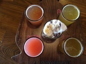 Flight of Funky Buddha Brewing that my wife put together.  Starting with the bottom left: Raspberry Berliner (great beer), Blueberry Cobbler Wheat Ale (had the flavor but too sweet), Pineapple Pilsner, and 3rd Year Anniversary IPA (solid).