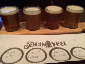 Point Ybel Brewing was the last stop before the Ft. Myers airport.  My wife karaokeed while I had a flight.  From left to right: Snook Bite, Dwarf Galaxy, Blow to the  Head, and No See Um Saison.