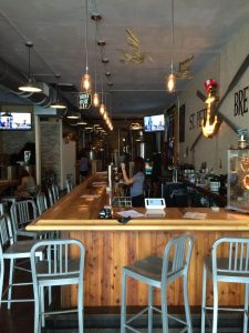 St. Pete Brewing is completely open, especially in late July.  Cool games make it welcoming to a family with kids.