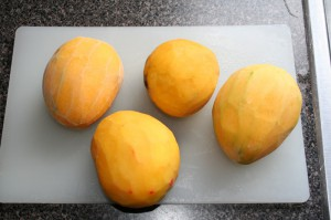 peeled mangos to go into mango saison
