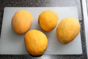 peeled mangos to go into mango saison