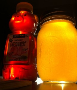 Sun hitting the honey jars just right.